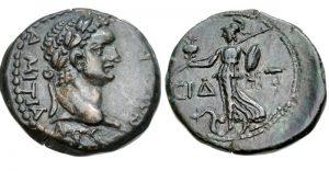 Ön yüzünde Tanrıça Athena'yı ve arka yüzünde şehrin sembolü olan Nar'a karşı çelenk uzatan Nike'yi betimleyen gümüş Side sikkesi.